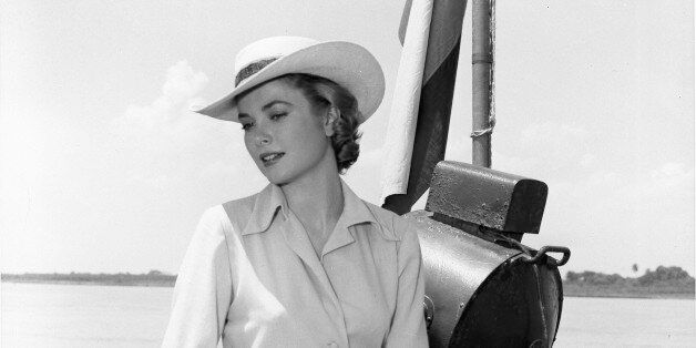 COLUMBIA - 1954:  Actress Grace Kelly sits on the rail of a boat on the Magdalena river during filming of the MGM movie 'Gree
