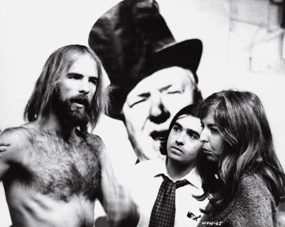 "Director Mike Wadleigh with Scorsese and Thelma Schoonmaker during the making of ""Woodstock."""