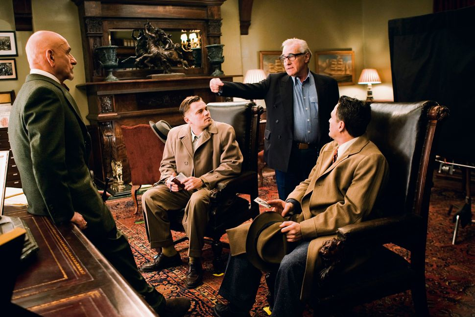 "Scorsese on the set of ""Shutter Island"" with Ben Kingsley, Leonardo DiCaprio and Mark Ruffalo."