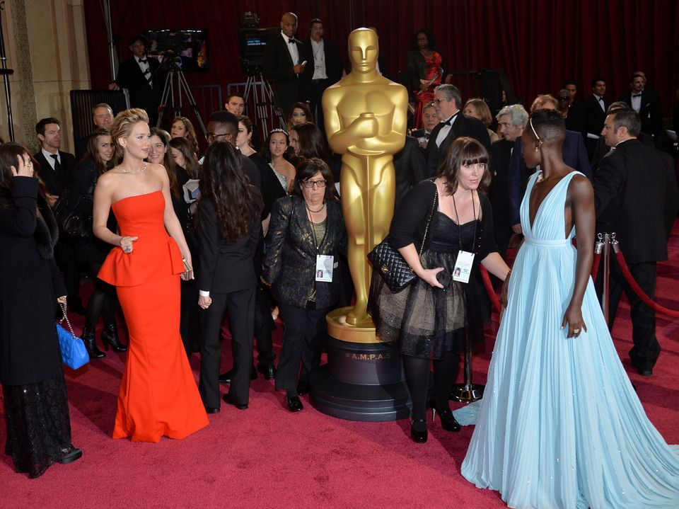 HOLLYWOOD, CA - MARCH 02:  Actresses Jennifer Lawrence (L) and Lupita Nyong'o attend the Oscars held at Hollywood & Highland