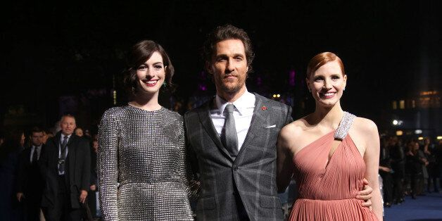 Actors Anne Hathaway, Matthew McConaughey and Jessica Chastain pose for photographers upon arrival at the premiere of the fil