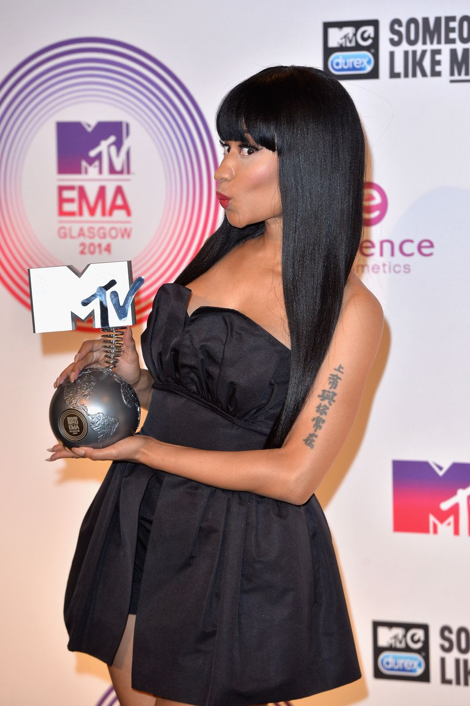 GLASGOW, SCOTLAND - NOVEMBER 09:  Nicki Minaj poses backstage with her Best Hip Hop trophy during the MTV EMA's 2014 at The H