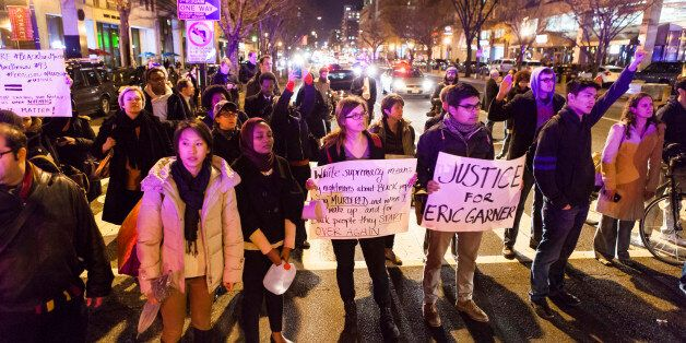WASHINGTON, DC - DECEMBER 03 :  Protestors block the road during a protest after two grand juries decided not to indict the p