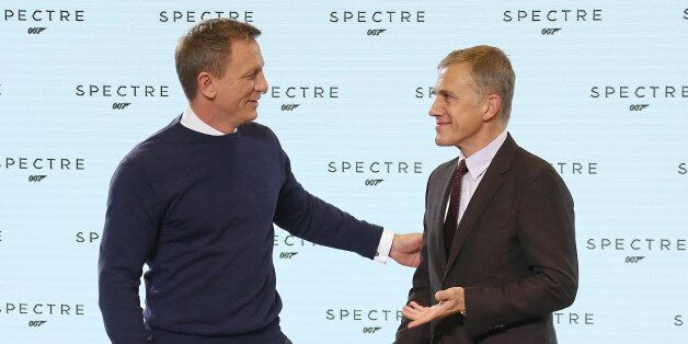 Actors from left, Daniel Craig and Christoph Waltz greet one another before they  pose for photographers at the announcement