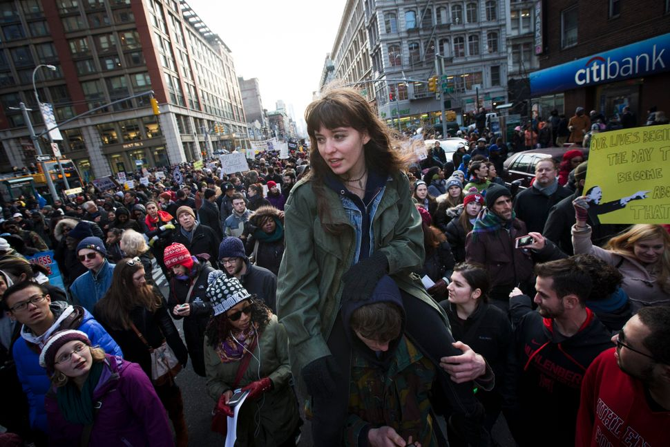 Demonstrators march in New York, Saturday, Dec. 13, 2014, during the Justice for All rally and march. In the past three weeks