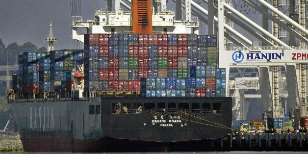 ** ADVANCE FOR SUNDAY, JUNE 30 ** A container ship is unloaded at the Port of Oakland in Oakland, Calif., Tuesday, June 25, 2
