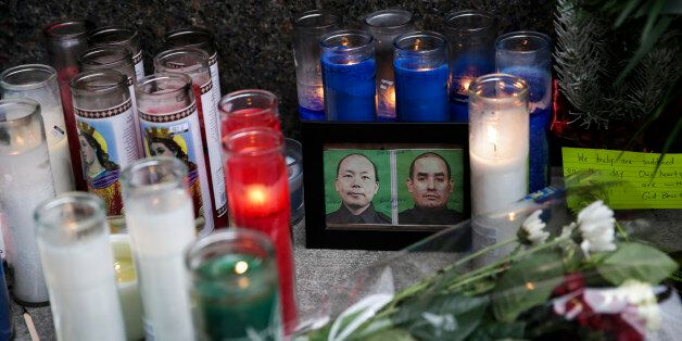 NEW YORK, NY - DECEMBER 22: A view of a memorial for slain NYPD officers, Wenjian Liu and Rafael Ramos, outside a police stat