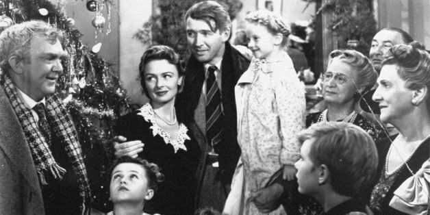 """James Stewart, center, is shown in the last scene of Frank Capra's 1947 film """"It's A Wonderful Life"""". Hollywood columnist Arm"""