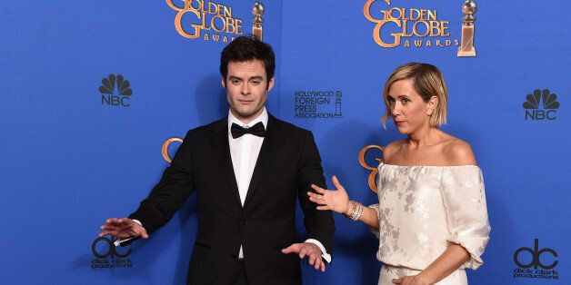 Bill Hader, left, and Kristen Wiig pose in the press room at the 72nd annual Golden Globe Awards at the Beverly Hilton Hotel