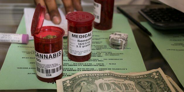 In this photo taken Tuesday, May 14, 2013, Medical marijuana prescriptions vials are filled at the Venice Beach Care Center m