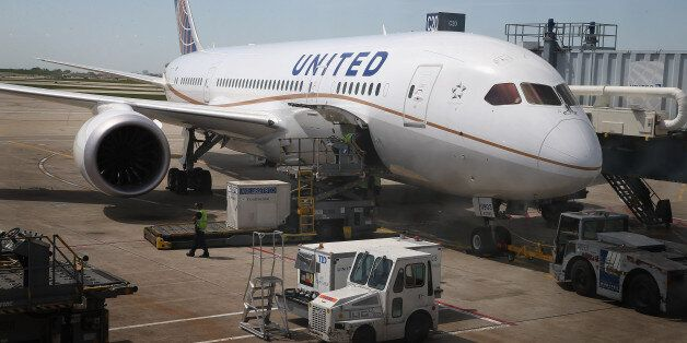CHICAGO, IL - MAY 20:  A United Airlines Boeing 787 Dreamliner is prepared for a flight at O'Hare International Airport after