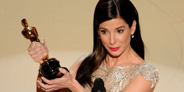 "Sandra Bullock accepts the Oscar for best performance by an actress in a leading role for ""The Blind Side"" at the 82nd Ac"