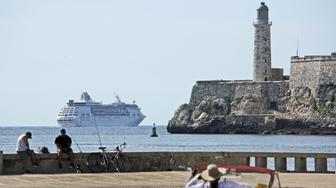 HAVANA, CUBA - JUN 05: The Empress of the Sea of Royal Caribbean International passes next to the El Morro fortress as leaving the harbor of Havana being the last US cruise ship to leave Cuba one day after the Trump administration had announced the ban of cruise ships from traveling to Cuba, on June 5, 2019, in Havana, Cuba. In an attempt to punish Cuba for its presumed support of Venezuela, the government of Donald Trump is further tightening the decade long embargo by the US on Cuba and reversing the policy of Barack Obama. The measure is expected to have a huge impact on Cuba's economy as traveling by cruise ship has become the mast favorite way of traveling to Cuba for US citizens. (Photo by Sven Creutzmann/Mambo photo/Getty Images)