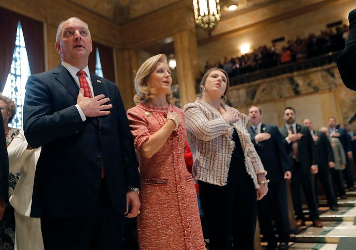 Louisiana Gov. John Bel Edwards with his wife, Donna Edwards, and their daughter Sarah Ellen Edwards during the pledge of all