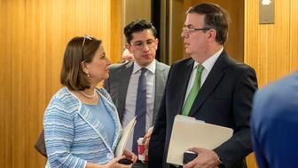 Mexican Ambassador Martha Barcena Coqui, left, and Mexican Foreign Affairs Secretary Marcelo Ebrard, right, speak before a news conference at the Mexican Embassy in Washington, Tuesday, June 4, 2019, as part of a Mexican delegation in Washington for talks following trade tariff threats from the Trump Administration. (AP Photo/Andrew Harnik)