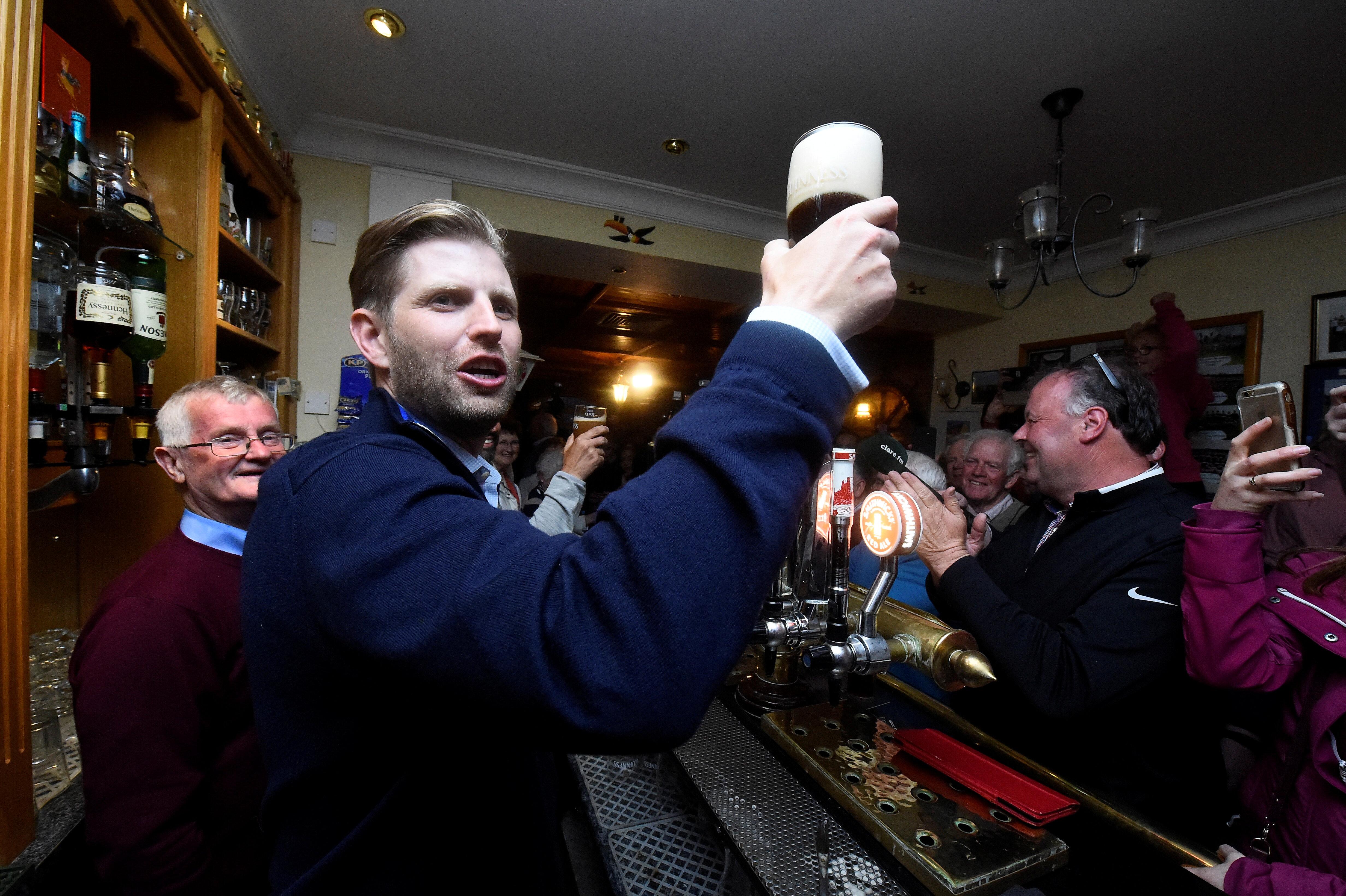 U.S. President Donald Trump's sons Eric and Donald Trump Jr. visit a local pub in Doonbeg village, Ireland June 5, 2019. REUTERS/Clodagh Kilcoyne