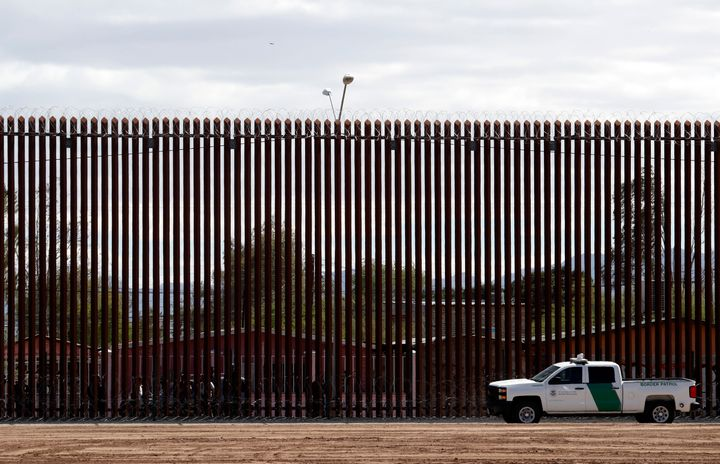 A U.S. Customs and Border Protection vehicle sits near a section of the U.S. border wall with Mexico in Calexico, California,