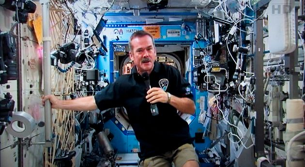 Canadian astronaut Chris Hadfield responds to a question during a news conference from the International...