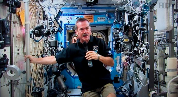 Canadian astronaut Chris Hadfield responds to a question during a news conference from the International Space Station on Jan. 10, 2013.