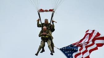 US WWII veteran Tom Rice (front) takes part in a parachute drop over Carentan, Normandy, north-western France, on June 5, 2019, as part of D-Day commemorations marking the 75th anniversary of the World War II Allied landings in Normandy. (Photo by BERTRAND GUAY / AFP)        (Photo credit should read BERTRAND GUAY/AFP/Getty Images)