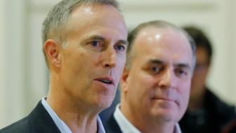 U.S. Representatives Dan Kildee, right, and Jared Huffman talk to media people at the Landstuhl Regional Medical Center in Landstuhl, Germany, Monday, Jan. 18, 2016. Four U.S. citizens who were released from an Iranian prison where transferred to Landstuhl for medical treatment. (AP Photo/Michael Probst)