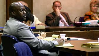 FILE - In this Feb. 6, 2004 file photo, Curtis Giovanni Flowers, left, listens to testimony in his third capital murder trial in Winona, Miss. Flowers has been convicted four times in six trials for the 1996 slayings of four workers at a Winona furniture store. Two trials in Montgomery County ended with hung juries. Flowers' fourth conviction came in 2010 and he was sentenced to death. In 2013, he is back before the Mississippi Supreme Court asking that his conviction and sentence be tossed out. (AP Photo/Winona Times, Dale Gerstenslager, Pool, File)