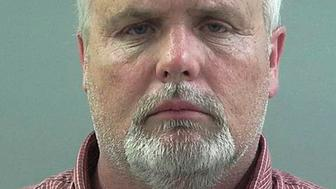 In this June 5, 2019, photo released by the Weber County Sheriff's Office is Scott Brian Haven. The Utah man is accused of making threatening phone calls to the U.S. Capitol, threatening to kill and hurt members of Congress. In charging documents unsealed Wednesday, June 5, 2019, federal prosecutors accuse 54-year-old Haven of making more than 2,000 phone calls to Washington offices of unnamed U.S. representatives and senators from 2017-2019. (Weber County Sheriff's Office via AP)