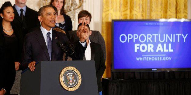 U.S. President Barack Obama talks before signing a Presidential Memorandum on modernizing the overtime system to help insure