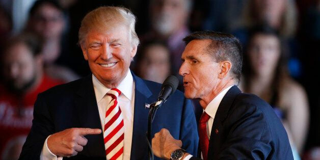 GRAND JUNCTION, CO - OCTOBER 18: Republican presidential candidate Donald Trump (L) jokes with retired Gen. Michael Flynn as