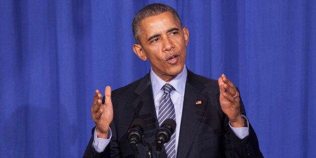 WASHINGTON, DC - NOVEMBER 9:  U.S. President Barack Obama makes remarks at an Organizing for Action dinner on November 9, 201