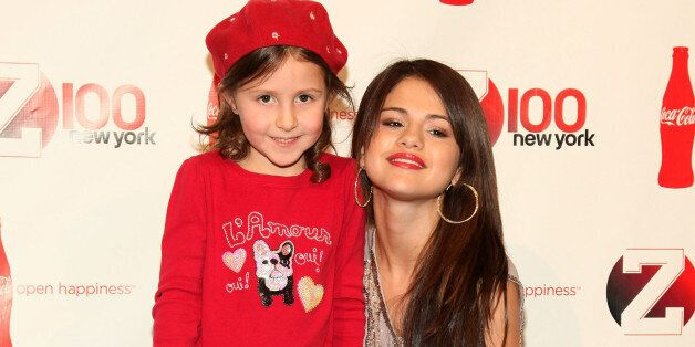 Selena Gomez (R) and a guest attend Z100 and Coca Cola's All Access Lounge pre-show at Hammerstein Ballroom on December 10, 2