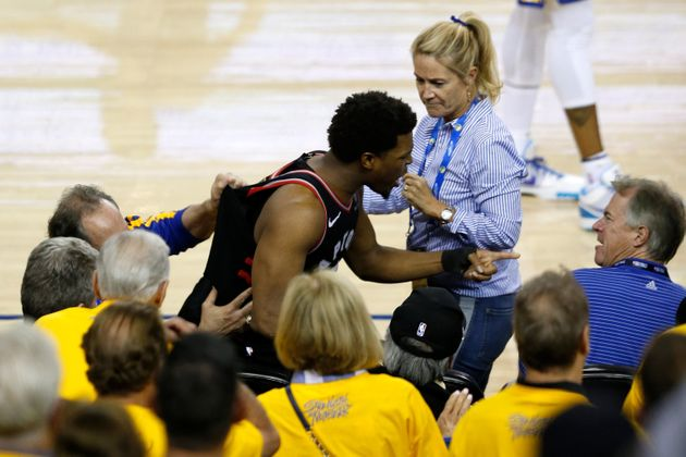 Raptors guard Kyle Lowry points at Warriors minority owner Mark Stevens after the