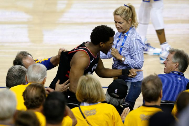 Raptors guard Kyle Lowry points at Warriors minority owner Mark Stevens after the incident.