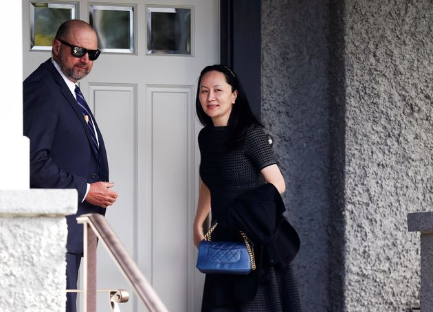 Huawei Chief Financial Officer Meng Wanzhou, right, who is out on bail and remains under partial house...