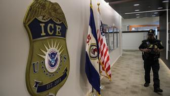 WASHINGTON, DC - MAY 11: A law enforcement officer walks past ICE logo ahead of a press conference on Thursday, May 11, 2017, at the U.S. Immigration and Customs Enforcement  headquarters in Washington, DC. (Photo by Salwan Georges/The Washington Post via Getty Images)