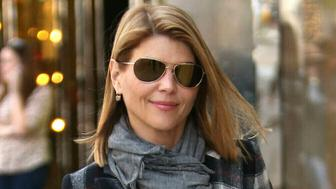 Photo by: STRF/STAR MAX/IPx 2019 4/9/19 Lori Loughlin Indicted in College Admissions Cheating Scandal. STAR MAX File Photo: 12/13/16 Lori Loughlin is seen in Los Angeles, CA.