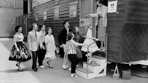 "FILE - In this Aug 20, 1957, file photo, Walt Disney's Mouseketeers enter a large trailer that serves as their school on the Disney lot in Hollywood, Calif. Greeting them is their teacher Jean Seaman of the Los Angeles Public School System. Jimmy Dodd, red-haired and fortyish, is master of Mouseketeer ceremonies. Mouseketeer Annette Funicello can be seen at far left. Police have confirmed that a body found in April 2019 at an Oregon home is that of missing man Dennis Day, who was an original member of Disney's ""The Mickey Mouse Club."" (AP Photo/Ernest K. Bennett, File)"