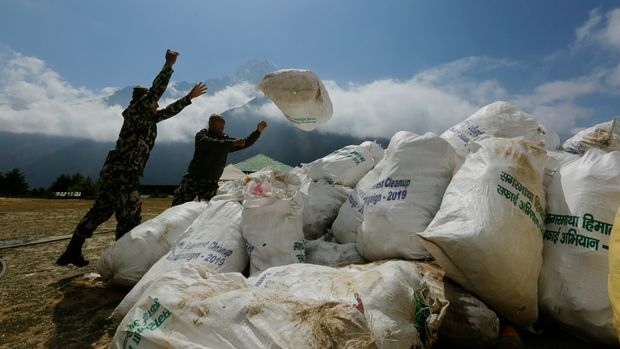 Nepalese army men pile up the garbage collected from Mount Everest in Namche Bajar, Solukhumbu district, Nepal, Monday, May 27, 2019. The garbage will be sent to Kathmandu for recycling. (AP Photo/Niranjan Shrestha)