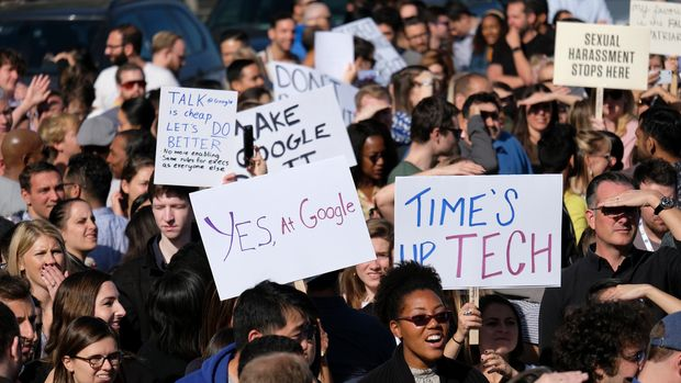 """Google employees hold up signs at Harry Bridges Plaza during a walkout Thursday, Nov. 1, 2018, in San Francisco. Carrying signs with messages such as """"Don't be evil,"""" several thousand Google employees around the world briefly walked off the job Thursday in a protest against what they said is the tech company's mishandling of sexual misconduct allegations against executives. (AP Photo/Eric Risberg)"""