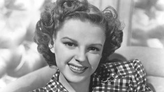 Judy Garland, wearing a checkered shirt, lounging on a chair, 1950. (Photo by Smith Collection/Gado/Getty Images)