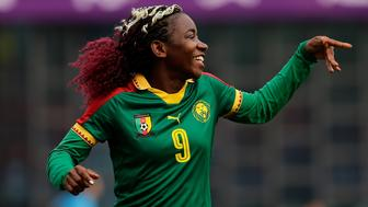 WUHAN, CHINA - APRIL 04:  (CHINA OUT) Madeleine Michele #9 of Cameroon celebrating goals during CFA team China international Women's football tournament Wuhan 2019 between Cameroon and Croatia at Hankou Sports Center Stadium on April 4, 2019 in Wuhan, China.  (Photo by Wang HE/Getty Images)