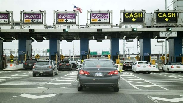 Traffic waits to pass through Robert F. Kennedy Bridge in New York City. Like many states, New York charges more for tolls to