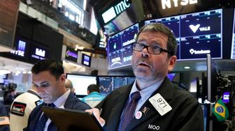 Trader James MacGilvray, right, works on the floor of the New York Stock Exchange, Thursday, June 6, 2019. Stocks are slightly higher Thursday as the market watches for the latest developments in U.S. trade disputes with China and Mexico. (AP Photo/Richard Drew)