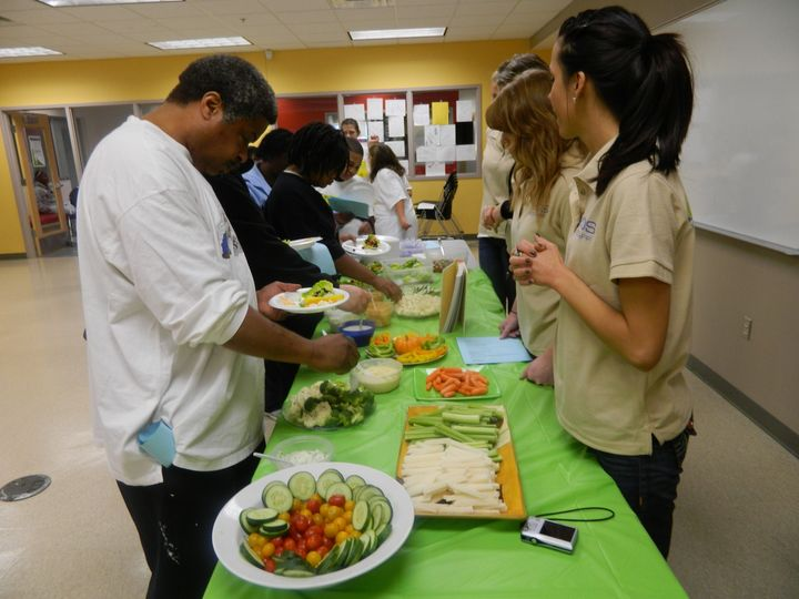 YFDS coaches teach members how to eat and budget for more vegetables in their diets.