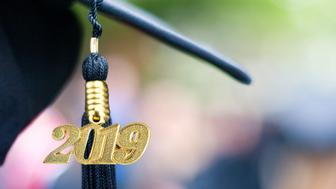Closeup of a 2019 Graduation Tassel at a graduation ceremony.