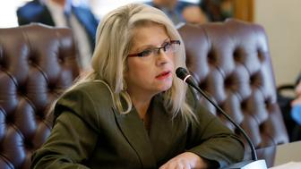 FILE - In this Jan. 28, 2015 file photo, Sen. Linda Collins-Smith, R-Pocahontas, speaks at the Arkansas state Capitol in Little Rock, Ark. Authorities in Arkansas say they're investigating as a homicide remains found outside the home of the former state senator who Republican Party officials say is dead. An Arkansas State Police spokesman said Wednesday, June 5, 2019, that the remains were found Tuesday outside the home in Pocahontas. Police declined to identify the victim. Property records show the home belongs to Collins-Smith and her ex-husband. (AP Photo/Danny Johnston, File)