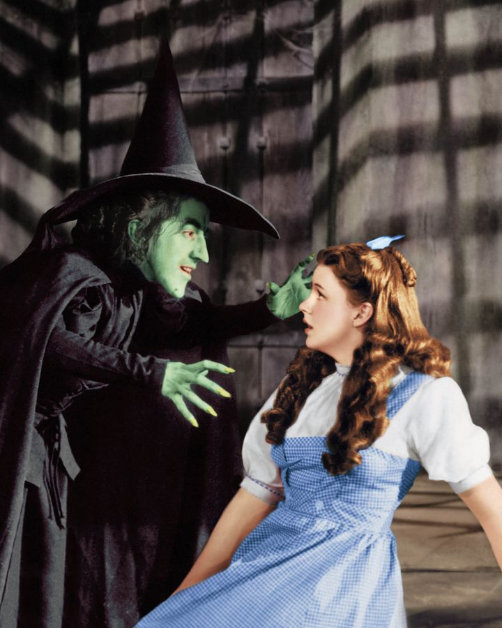 "Judy Garland as Dorothy Gale, with Margaret Hamilton, in ""The Wizard of Oz."""