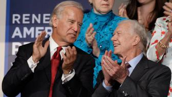 Former President Jimmy Carter, right, is seen with Democratic vice presidential candidate Sen. Joe Biden, D-Del., at the Democratic National Convention in Denver, Tuesday, Aug. 26, 2008. (AP Photo/Paul Sancya)
