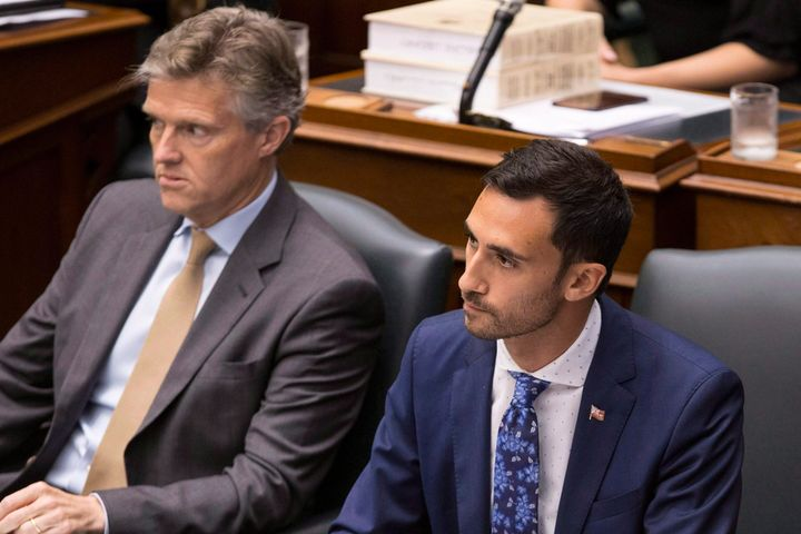 PC MPPs StephenLecce, right, and Rod Phillips, left, sit in the legislature in Toronto on July 31, 2018.