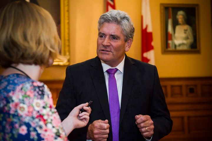 Interim Liberal leader John Fraserspeaks to a reporter in the lobby at Queen's Park in Toronto on July 11, 2018.